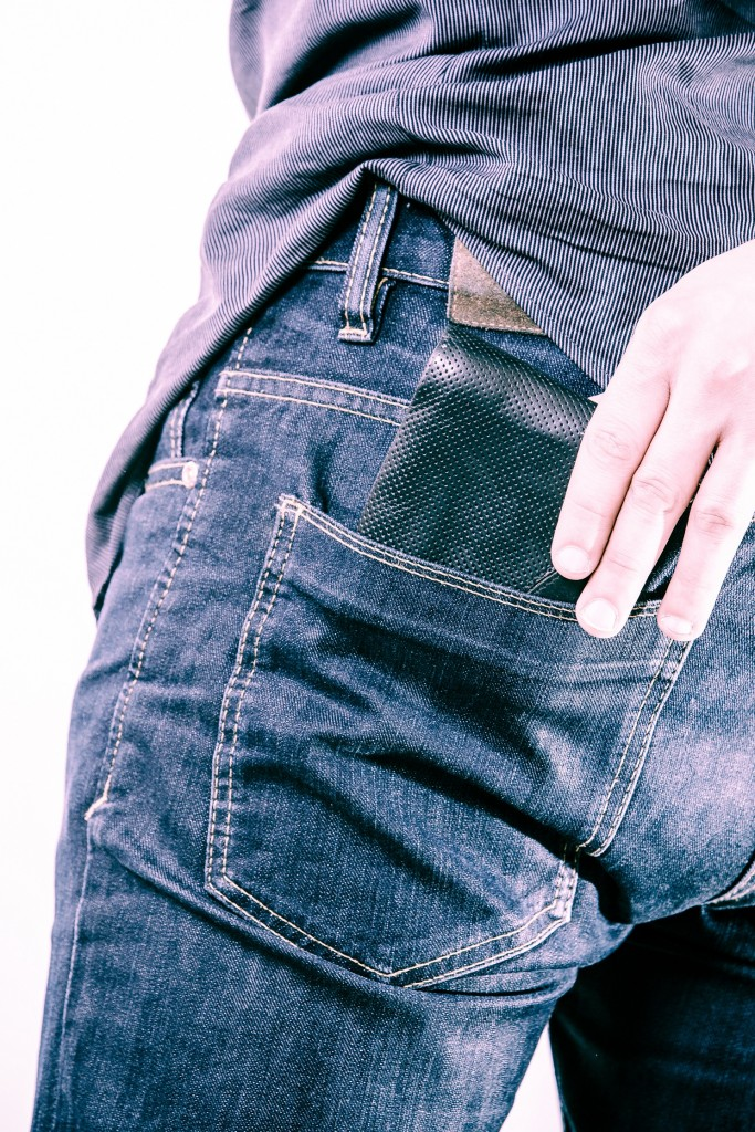 Closeup. Careless man taking wallet out on back pocket. Theft.